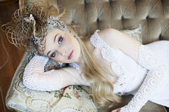 Bright retro bride in luxury vintage interiors with elegant hairstyle Stock Photography