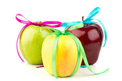 Bright ripe apples and colored ribbons. On a white background Stock Images