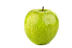 Bright ripe green apple in water drops. On a white background Royalty Free Stock Photo
