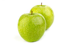 Bright ripe green apples in water drops. On a white background Royalty Free Stock Photo