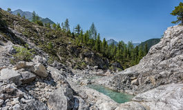 Bright rocks in narrow valley of mountain stream Stock Photography