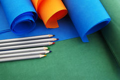 Bright rolls of color paper with colored pencils Stock Photos