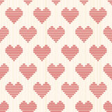 Bright romantic background with hearts. Seamless. Stock Photos