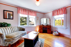 Bright room with antique sofa and dresser cabinet with mirror Royalty Free Stock Photography
