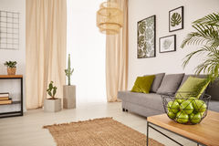 Bright room with earthy design. And bowl of apples royalty free stock photo