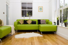 Bright room with modern decor. A modern furnished room with bright tasteful decor Royalty Free Stock Photography