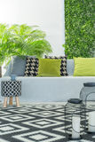 Bright room with sofa royalty free stock image