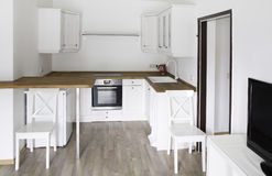 Bright room, with white kitchen furniture Stock Photography