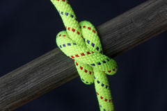 Bright rope tied around wood Stock Photos