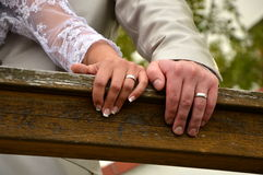 Bright's and groom's hands with wedding rings Stock Image