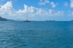 Bright sailboat, yacht on calm sea Stock Photo