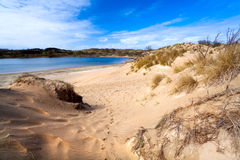 Bright sandy hills and lake Stock Image