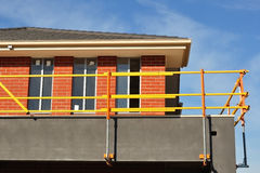 Bright scaffolds on new house Royalty Free Stock Photos