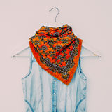 Bright scarf print Turkish cucumber with denim clothing. fashion. Combination Royalty Free Stock Image