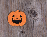 Bright scary pumpkin decoration on rustic wooden boards royalty free stock photos