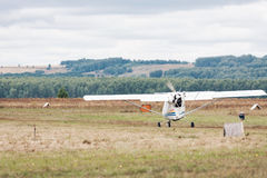 Bright scenic landscape with small propeller plane takes off at the grass. There are trees on background. Selective. Bright scenic landscape with small propeller royalty free stock photos