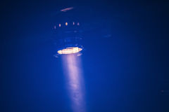 Bright scenic spot light over dark blue Royalty Free Stock Photos