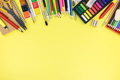 Bright school supplies for education on yellow background Royalty Free Stock Image