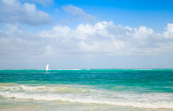 Bright sea landscape with cloudy sky and lonely sail Royalty Free Stock Photo