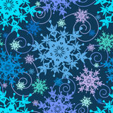 Bright seamless pattern with colorful snowflakes. Beautiful bright dark blue background seamless pattern with colorful ornate snowflakes and swirls. Seasonal Royalty Free Stock Images