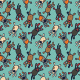 Bright seamless pattern with cute cartoon dogs Stock Photos