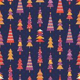 Bright seamless pattern with fir trees. Bright seamless pattern with fun multicolored decorated fir trees in red, yellow and purple colors on dark blue Stock Photos