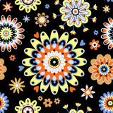 Bright seamless pattern with flowers on black background. Royalty Free Stock Images