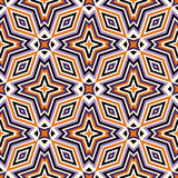 Bright seamless pattern with geometric ornament in Halloween traditional colors. Colorful abstract background. Ethnic and tribal motifs. Ornamental vivid Stock Image