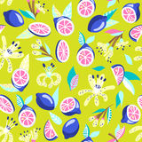 Bright seamless pattern with lemons. Vector seamless pattern with bright lemons on a green background. Bright summer design vector illustration