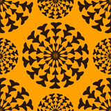 Bright seamless pattern. With round black pattern on orange background. The ornament consists of the abstract branches of hearts. Vector eps 10 royalty free illustration