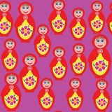 Bright seamless pattern with a Russian matryoshka  Stock Images