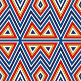 Bright seamless pattern with symmetric geometric ornament. Colorful abstract background. Ethnic and tribal motifs. Ornamental vivid wallpaper. Vector royalty free illustration