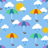 Bright seamless pattern with umbrellas in the rain Royalty Free Stock Images