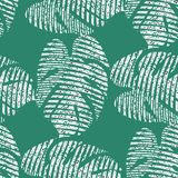 Bright seamless vector pattern with tropical leaves. royalty free stock photo
