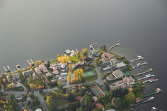 Bright Serene Neighborhood Peninsula. Aerial view of wealthy neighborhood along a lake Royalty Free Stock Image