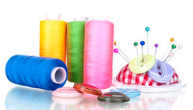 Bright sewing buttons, needle and skeins of thread Stock Images