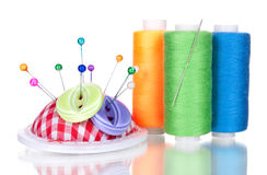 Bright sewing buttons, needle and skeins of thread Royalty Free Stock Image