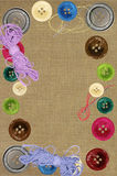 Bright sewing buttons and needles Stock Image