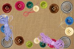 Bright sewing buttons and needles Royalty Free Stock Images