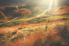 Bright Shafts of Light Around the road running through Peak District Royalty Free Stock Photo