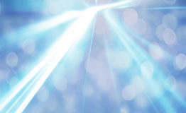 Bright shining sun with lens flare. Soft blue background with bo stock image