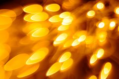 Shining Christmas lights. Festive background. Bright shining yellow lights of Christmas garland. Festive bright background royalty free stock images