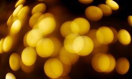 Shining Christmas lights. Festive background. Bright shining yellow lights of Christmas garland. Festive bright background stock photo