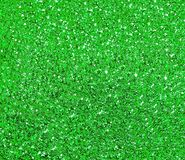 Sparkling green background with large sequins stock photos
