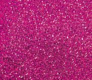 Sparkling purple background with large sequins. Bright shiny festive purple background with sequins closeup of new year`s eve stock photography