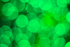 Bright shiny green bokeh lights background for celebration greet Royalty Free Stock Image