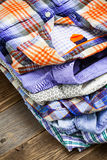 Bright shirts in a pile Stock Images