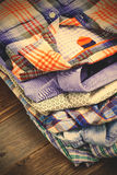 Bright shirts in a pile Royalty Free Stock Images