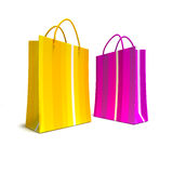 Bright shopping bags in pink and yellow Royalty Free Stock Photography