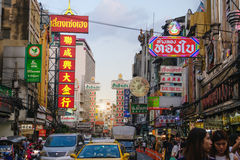 Bright signs of the stores, restaurants and car on china town Yaowarat Road Royalty Free Stock Photo